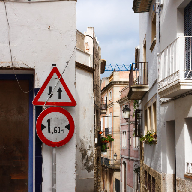 """Narrow street in the old town of Sitges by the town hall square,"" stock image"