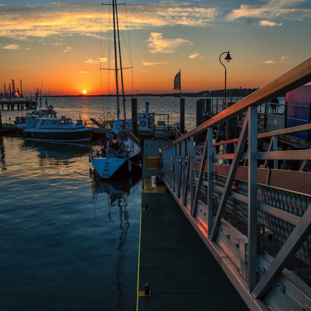 """Final Sun Moments Ha'penny Pier Harwich"" stock image"