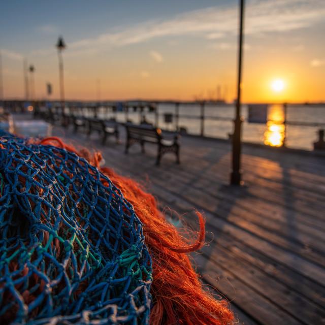 """Ha'penny Pier Fishing net Sunset"" stock image"