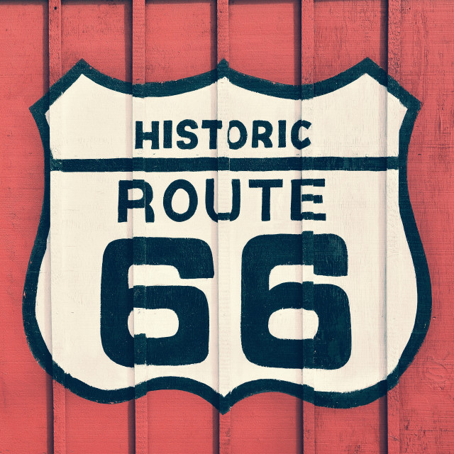 """Route 66 sign with wooden background."" stock image"
