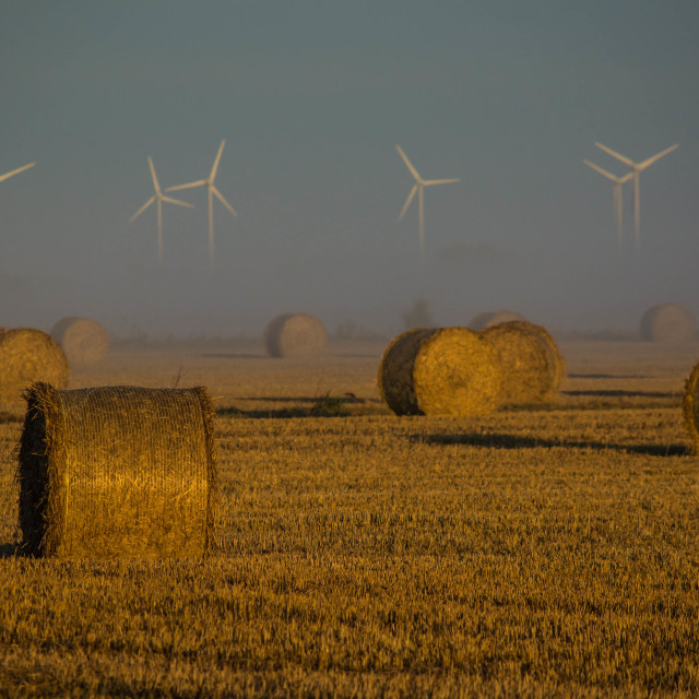 """""""Straw bales and wind turbines"""" stock image"""