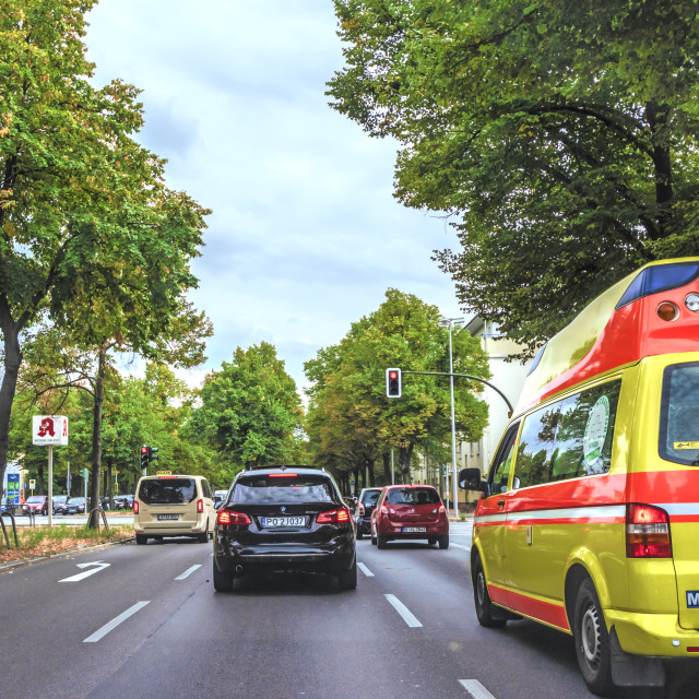 """""""Street scene at a large intersection with ambulance, taxi and other cars on the outskirts from Berlin, Mariendorf"""" stock image"""