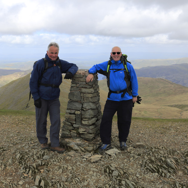 """""""Walkers at the summit of Helvellyn fell, Lake District National Park,..."""" stock image"""