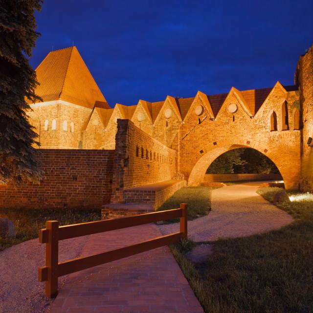 """Teutonic Knights Castle at Night in Torun"" stock image"