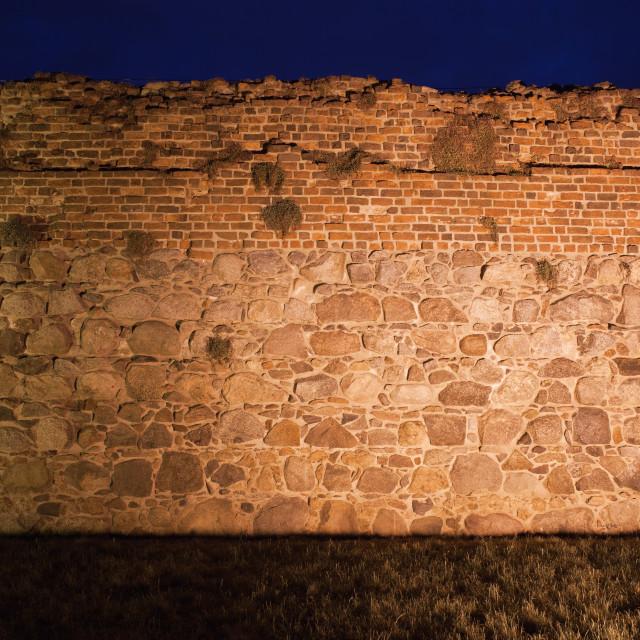"""Castle Wall Background Illuminated at Night"" stock image"
