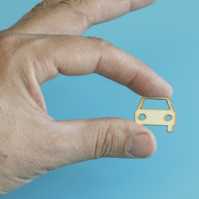 """Car insurance. Man is holding car. my car. man hand holding car on a blue..."" stock image"