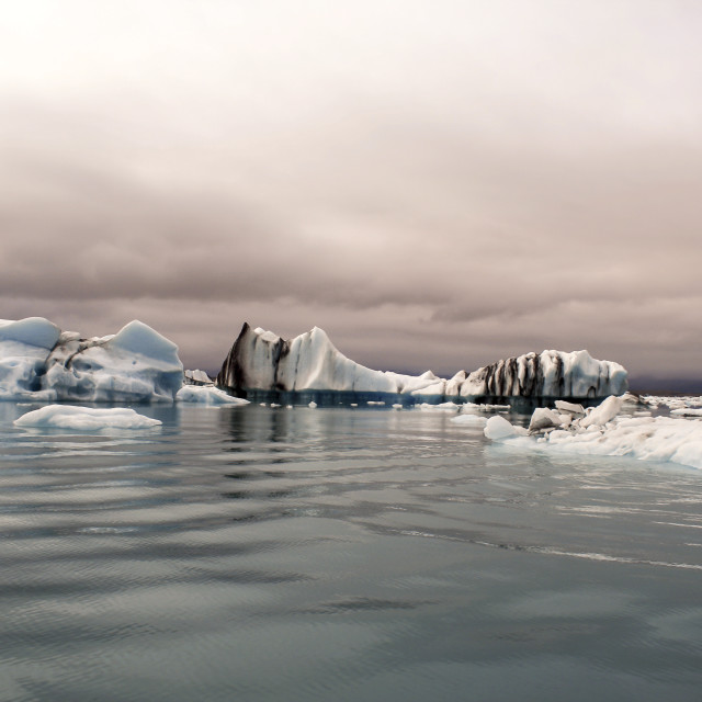"""Icebergs in lake"" stock image"