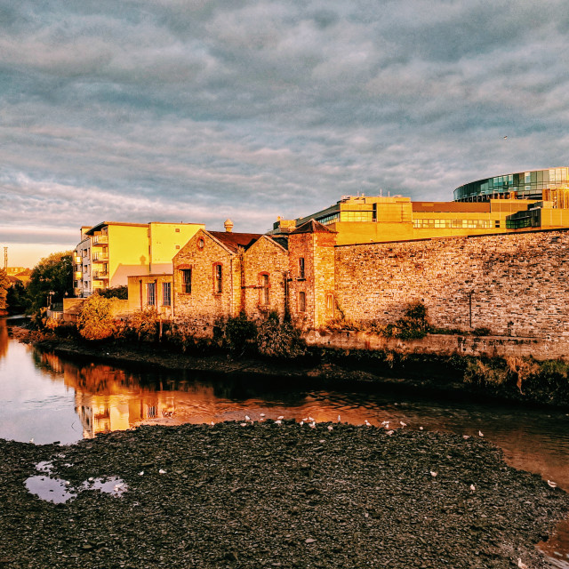 """""""A view on the River Liffey in Dublin at sunrise."""" stock image"""