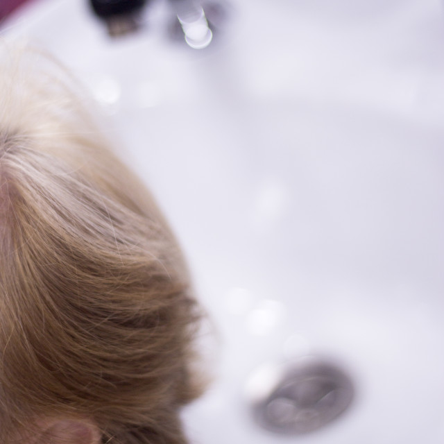 """""""Hairdresser washing a clients head"""" stock image"""