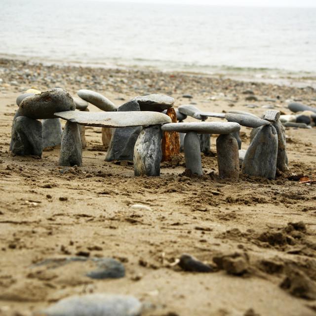 """Stonehenge on the beach"" stock image"