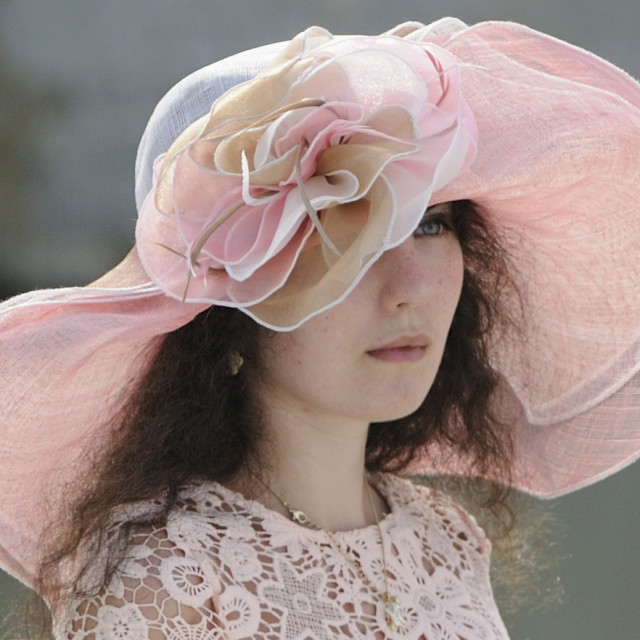 """Girl in a pink hat"" stock image"