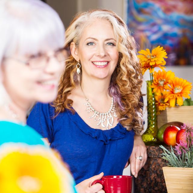 """Smiling Kitchen Woman"" stock image"