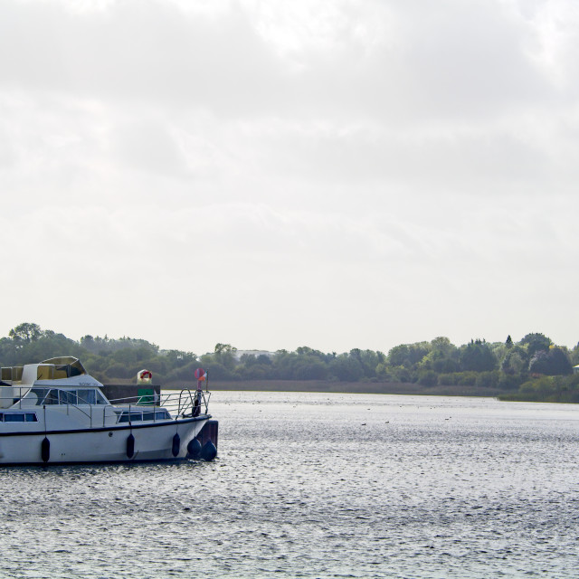 """""""Boat on the River Shannon, Ireland."""" stock image"""
