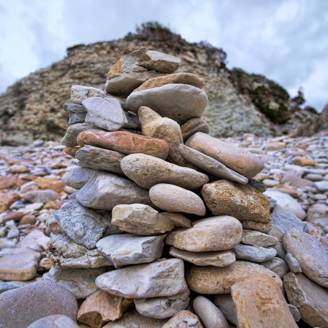 """""""A stack of rocks on a beach in Paxos, Greece"""" stock image"""