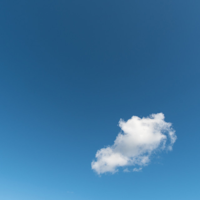 """""""Summer sky with one fluffy cloud"""" stock image"""