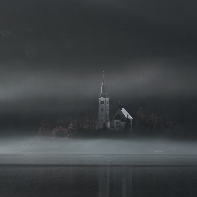 """Church on Bled Island in fog"" stock image"