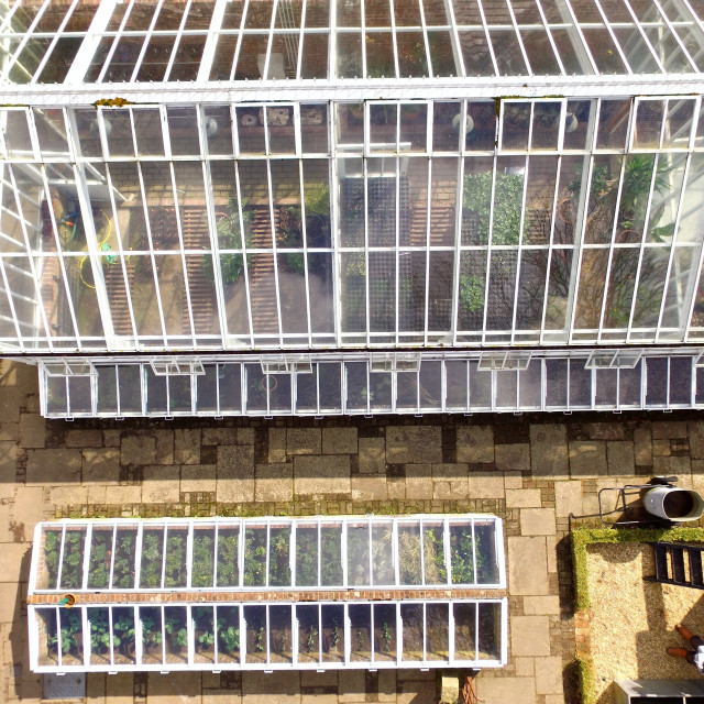 """Aerial shot of a large greenhouse and cold-frame."" stock image"