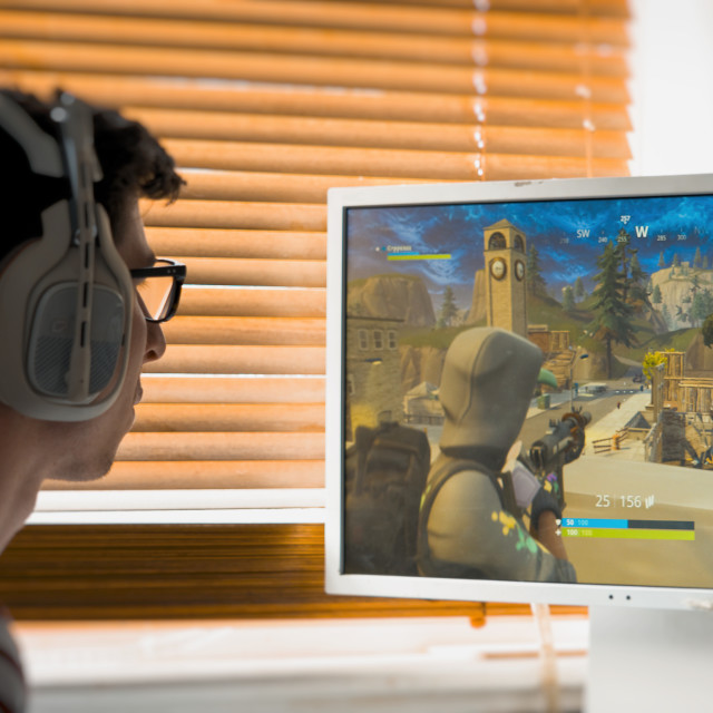 """Teenager playing Fortnite video game"" stock image"