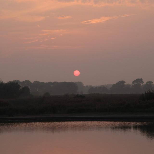 """Sunset over lake"" stock image"