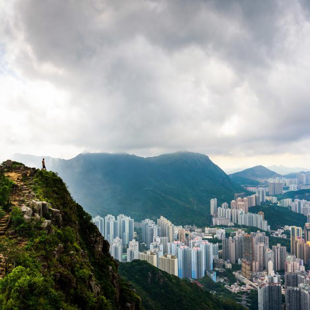 """Man enjoying fogy Hong Kong view from the Lion rock"" stock image"