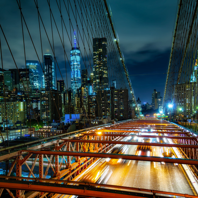 """Manhattan from the Brooklyn Bridge at Night"" stock image"