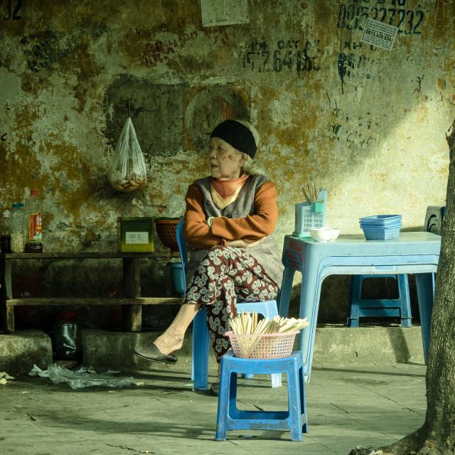 """Woman relaxing in the shade 2, Hanoi, Vietnam"" stock image"