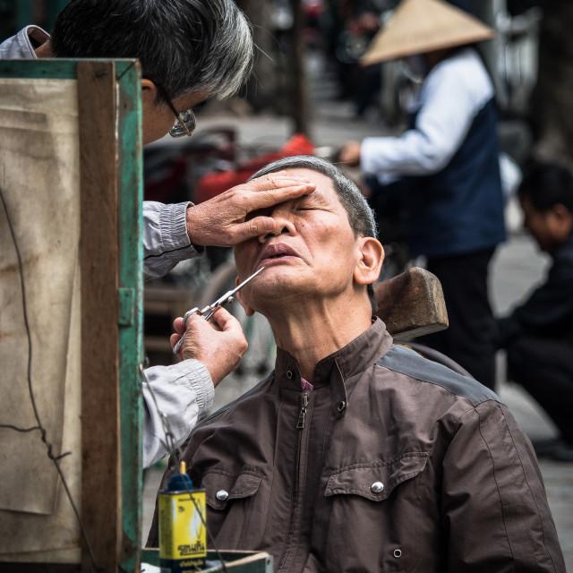 """Street barber, Hanoi, Vietnam"" stock image"