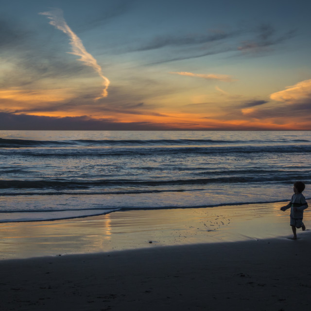 """""""Playing On A Beach At Sunset"""" stock image"""