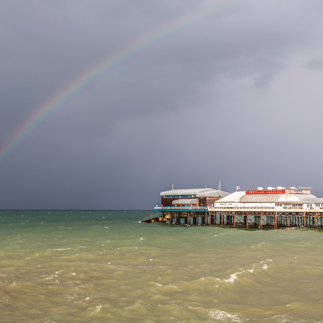 """""""Rainbow over the North Sea and Cromer Pier"""" stock image"""