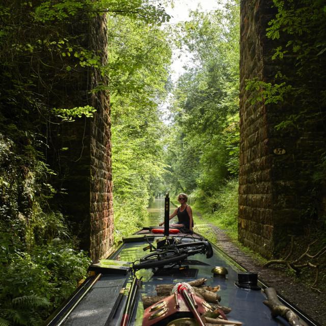 """Woman steering a narrowboat"" stock image"