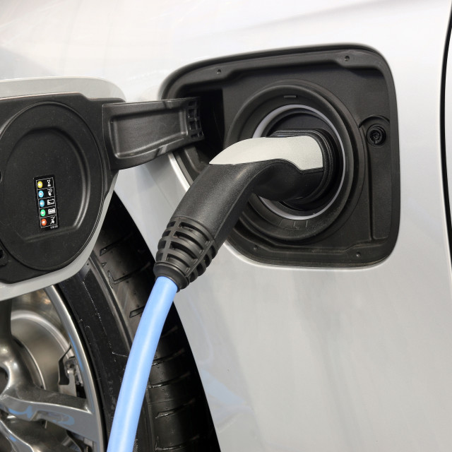 """electric car is charging"" stock image"
