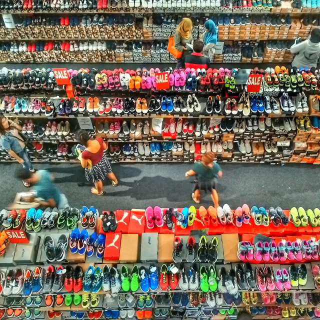 """Massive Sports Shoes Sale wide Angle Photo from Above with LOTS of Colour!"" stock image"