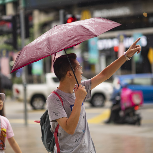 """Street Photo - Rainy Day (pointing)"" stock image"