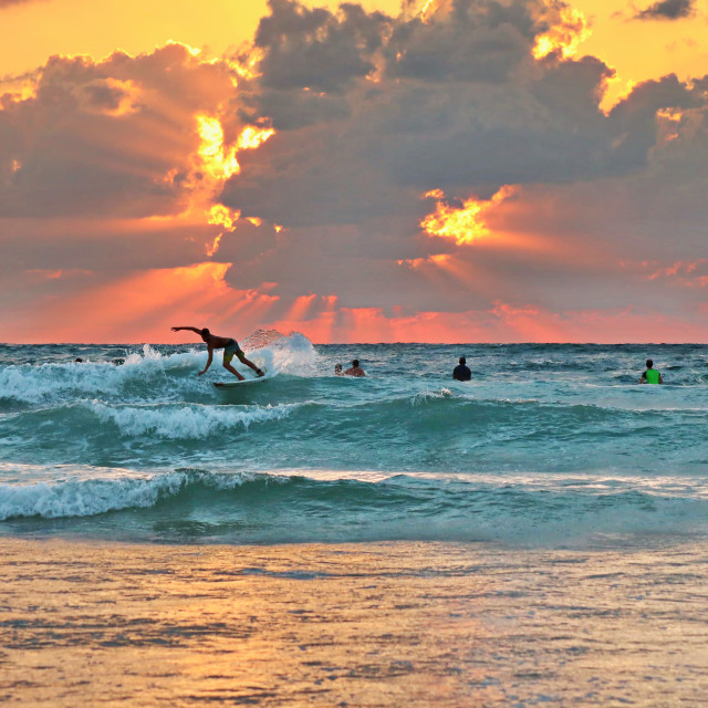 """Sunset and surfers"" stock image"