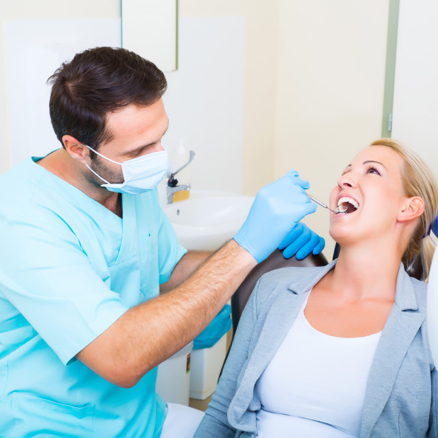 """Adult woman getting her checkup at the Dentist"" stock image"