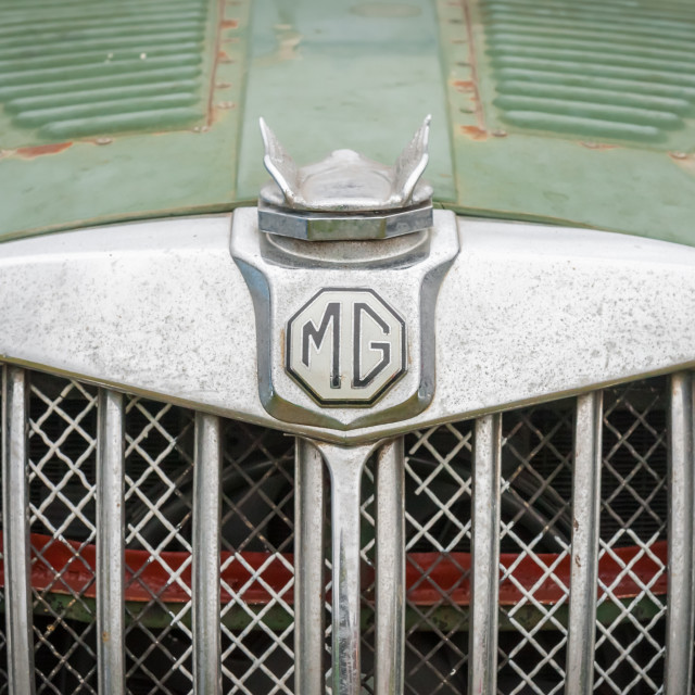 """vintage MG vehicle badge"" stock image"
