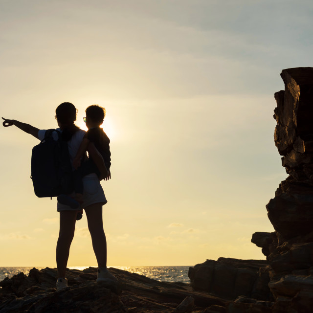 """Silhouette family enjoy sunset and sea"" stock image"
