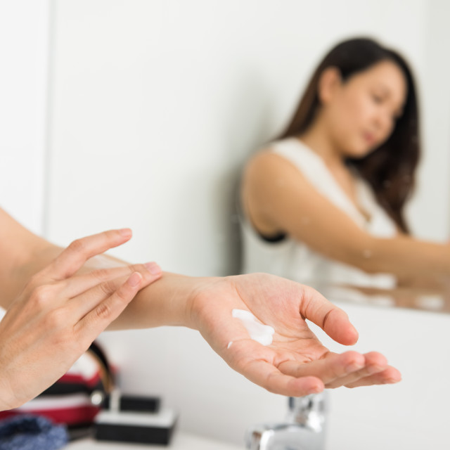 """lotion to female hand and arm"" stock image"