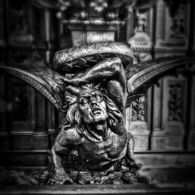 """Sculpture of the devil in wood"" stock image"