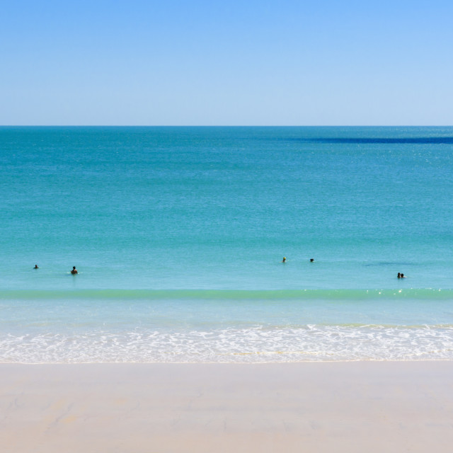 """People swimming at Cable Beach, Broome"" stock image"