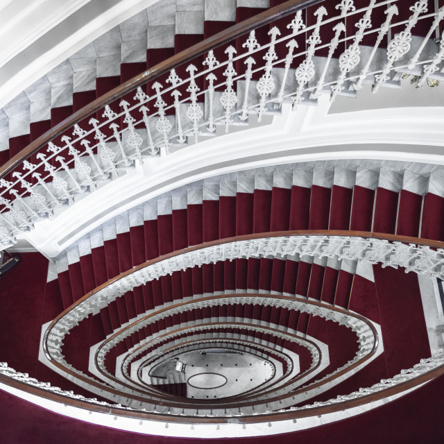 """Spiral staircase in red and white"" stock image"