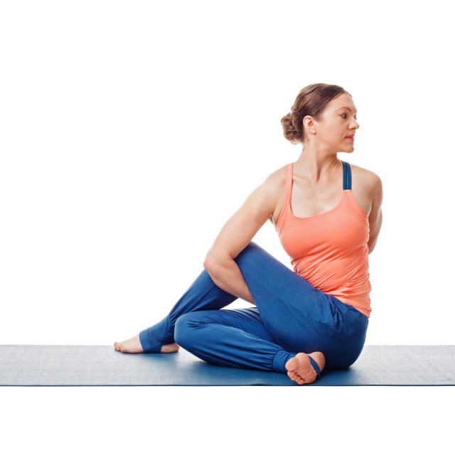 """Woman doing Ashtanga Vinyasa Yoga asana Marichyasana D"" stock image"