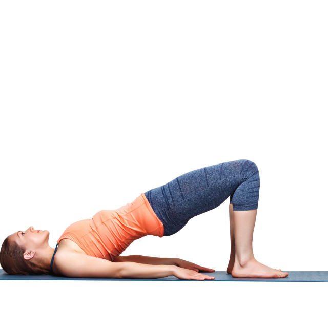 """""""Beautiful sporty fit yogi girl practices yoga asana setu bandhasana"""" stock image"""