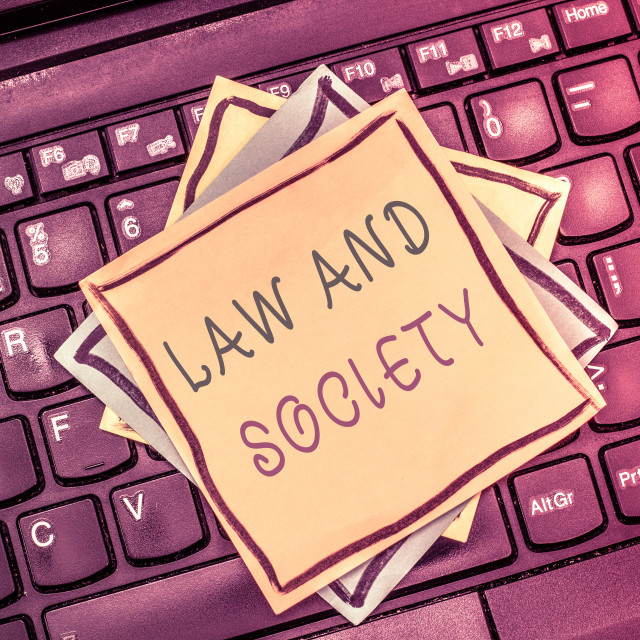 """""""Text sign showing Law And Society. Conceptual photo Address the mutual..."""" stock image"""