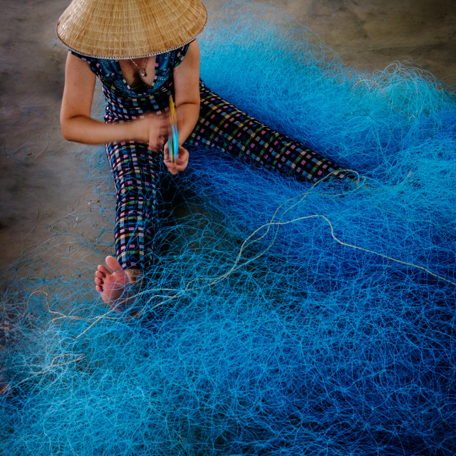 """Fish-Net-Worker 2"" stock image"