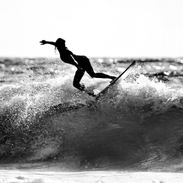 """A surfer in black and white"" stock image"