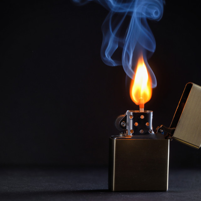 """Golden metal lighter and smoke"" stock image"