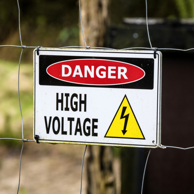 """""""High voltage sign on a fence"""" stock image"""