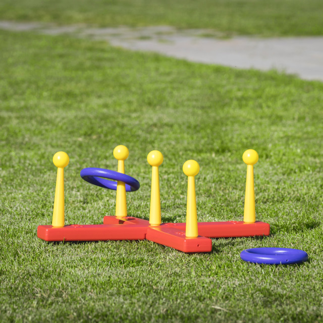 """Ring throw summer game on a green lawn"" stock image"
