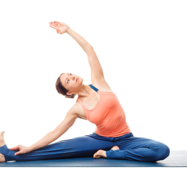 """Sporty fit yogini woman practices yoga asana parivrtta janu sirs"" stock image"